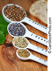 Herbs - Old table-top selection of herbs and grains in...