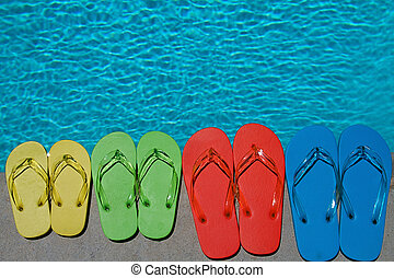 Summer Flipflops - Colored flipflops of a family of four by...