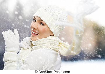 wintertime - a beauty girl on the winter background