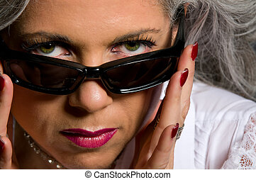 Woman looking over sunglasses - Attractive woman in her...