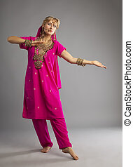 Dancer stand in rose oriental indian costume