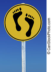 Feet Sign - Footprints on a road sign isolated on a blue...