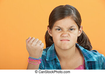 Angry Little Kid - Angry Latina kid with clenched fist on an...