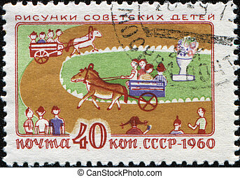 dessin - children riding on a pony - USSR-CIRCA 1960: A post...