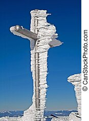 frozen cross on mountain summit
