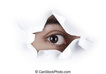 Eye Looking Through A Paper Hole - Isolated image of single...