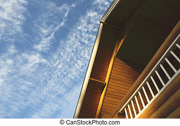roof of contry house over blue sky