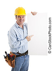 Construction Worker Points to Sign - Construction worker...