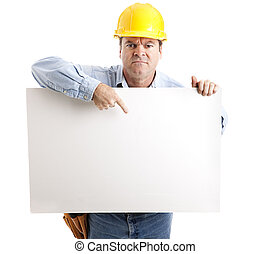Angry Worker with Sign - Angry construction worker points to...