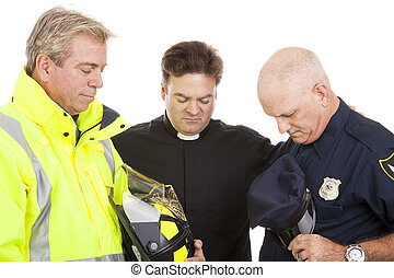 Praying Together - Priest of minister leads a firefighter...