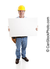 Construction Worke with Sign - Construction worker smiling...