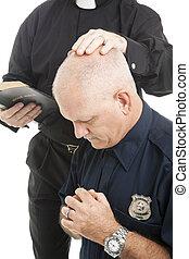 Policeman in Prayer