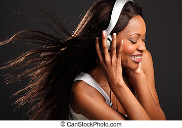 Beautiful woman listening to music - Headshot of beautiful...
