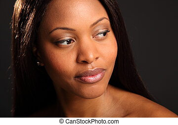 Beautiful serene black woman - Landscape style headshot of...