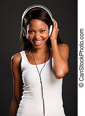 Smile from beautiful music fan - Beautiful happy african...