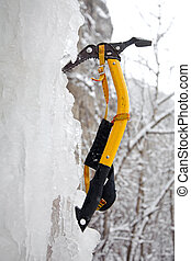 Climbing ice ax in the white ice fall