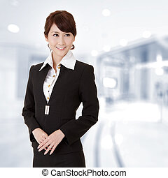 Successful young executive woman smiling, closeup portrait...
