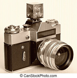 Old black 35mm SLR camera isolated on white