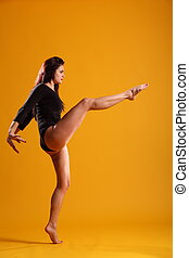High kick dance move in profile - Side on profile view of...
