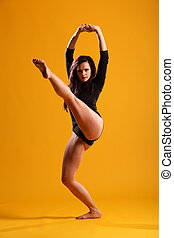 High kick dance move by dancer - Beautiful young female...