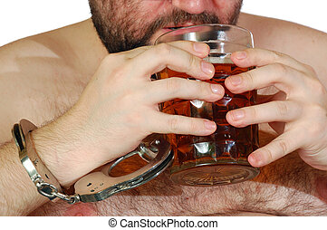 alcoholism - obese man chained with cuffs to a mug of beer