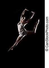 Athletic dancer leaping in air - Beautiful young female...