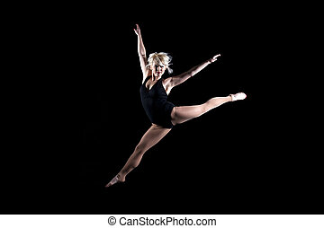 Girl gymnast leaping in the air - Beautiful young woman...