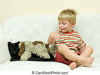Family Cat and young child. - Family Cat shows patience as...