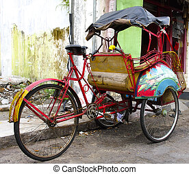 tricycle rickshaws on the streets of Yogyakarta ,Java,...