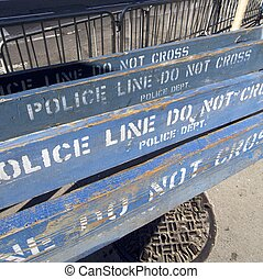 police line - group of wooden police barricades in the city...