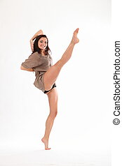 High kick from studio dancer - Beautiful young female dancer...
