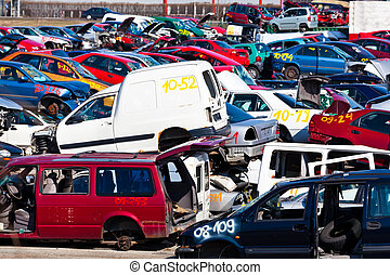 Cars in a junkyard - Old cars are appelt confess to a scrap...