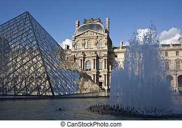 Louvre Fountain - Louvre Museum in sunshine with fountain...