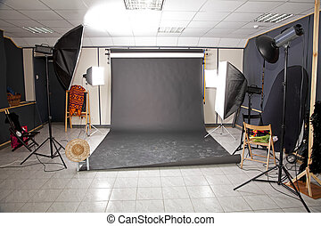 Professional studio interior with black background and...