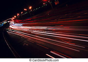 Nigh highway. Cars headlights in motion blur. Long exposure...