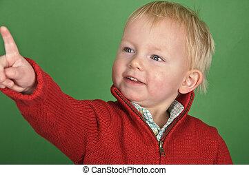portrait of a little boy on a green screen - photo portrait...