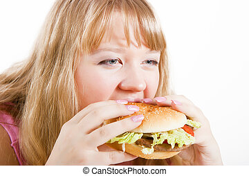 The young woman and hamburger - The young hungry woman bites...