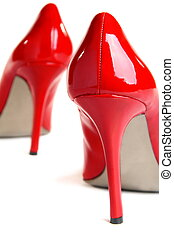 Red high-heeled shoes on a white background. - Red...