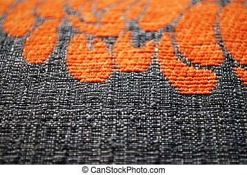 Gray and orange fabric texture macro detail background...