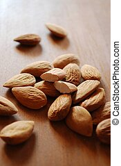Almonds - Shelled almonds on natural wooden table background