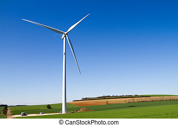 Wind turbine under clear blue sky - A wind turbine under...
