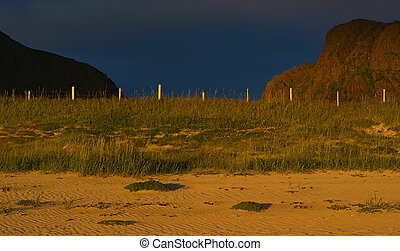 Beach on the Lofoten, Norway close to Flakstad lit by the...