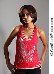 Beautiful mixed race girl in red - Portrait of beautiful...
