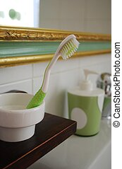Toothbrush in bathroom - Green and white toothbrush in the...