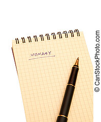 monday - yellow notebook and pen