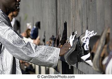 footwear  - The Moslem leaves footwear before a prayer.