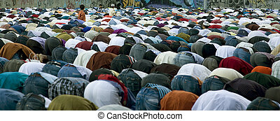Moslems during a prayer.