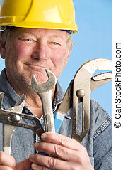 smiling happy contractor builder with tools