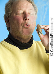 handsome middle age man smoking expensive cigar