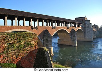 Covered bridge on Ticino river - Old covered bridge on...